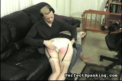 Acup cutie spanked and paddled by man and fancy woman